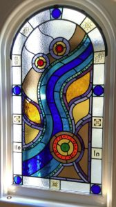 Colourful arched landing window for house in Hampton.