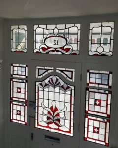 A classic stained glass frontage in bright red with clear textures.