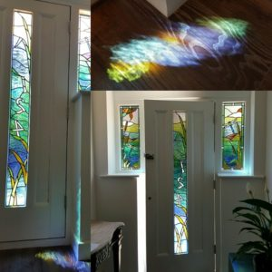 Detail for colour reflections from river inspired stained glass panels in Ripley, Surrey.