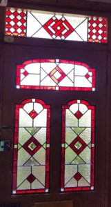 Inside view of dramatic Art Deco style stained glass design in red and clear textures.