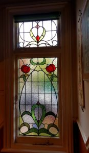 Classic Edwardian landing panels featuring red stylised flowers for house in Ashford, Middlesex.