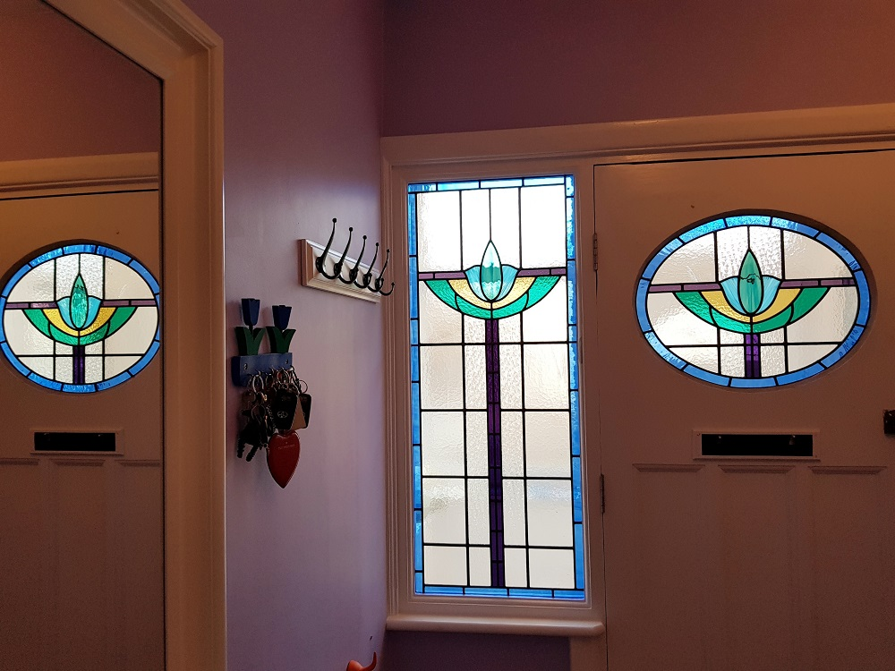 Art Deco style panels in shades of blue, purple and green for house in North London.