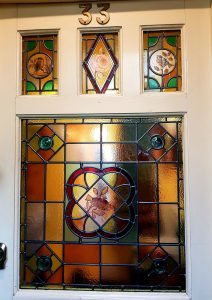 Stained glass door panels with painted birds restored for house in Hertford.