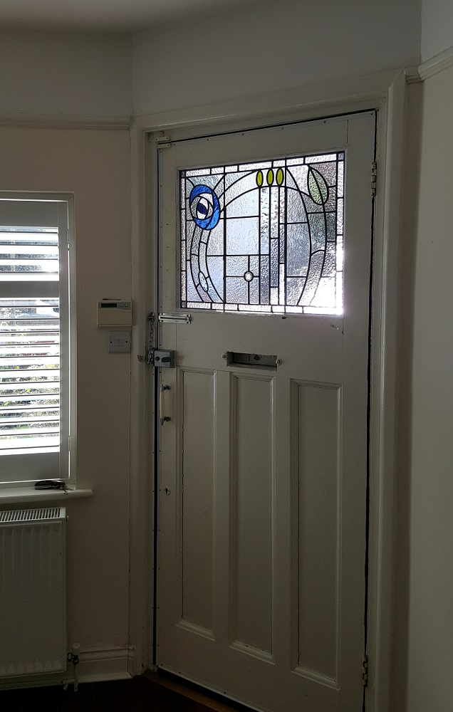 A Charles Rennie MacKintosh inspired stained glass door panel for house in Maidenhead. Berkshire.