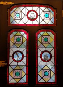 Inside view of stained glass frontage in South London showing painted roundels.